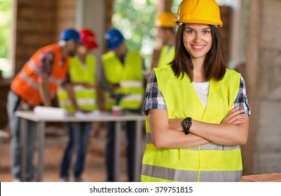 Portrait of young student of architecture on construction site