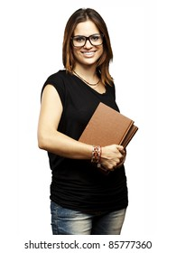portrait of young student with glasses holding a old book over white background