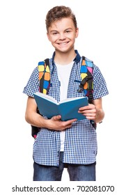 Portrait of young student with school bag and books. Teenager smiling and looking at camera. Happy teen boy, isolated on white background.