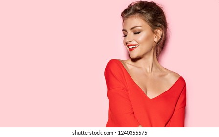 Portrait of young stunning model with bright impressive red lips. Studio photo shoot of pretty woman in fashionable sweater. Modern fashion and youth concept