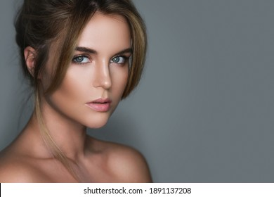 Portrait of young and stunning woman with a natural makeup