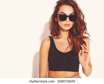 Portrait of young stylish girl model in casual summer clothes  with natural makeup in sunglasses isolated on white background