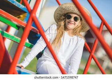 Portrait of young stylish girl with sunglasses and hat