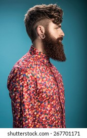 Portrait of young stylish guy on blue background