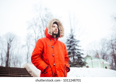 ead687e5ec657 Portrait of a young stylish man with beard dressed in red winter jacket  with hood and