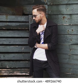 Portrait of young stylish man outdoors. Men's style.