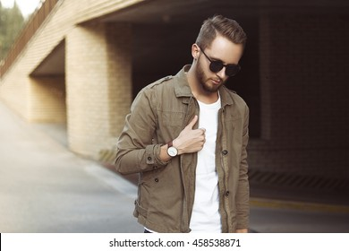 Portrait of young stylish man  in the street, life style