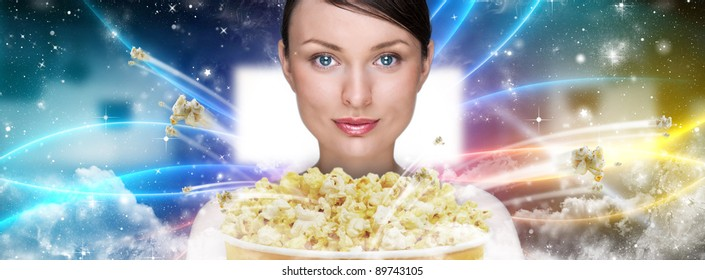 Portrait of young stylish modern woman  watching movie at modern cinema and eating exploding popcorn.