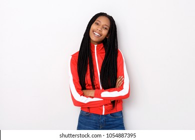Portrait of young stylish woman in red jacket standing with arms crossed on white background