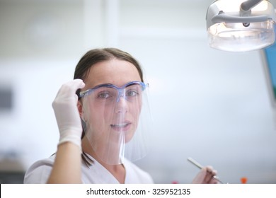 Portrait of a young success doctor wearing a face shield