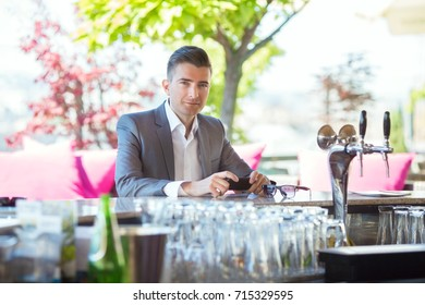 Portrait of young and successful bar owner at work