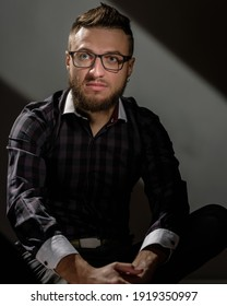 Portrait of young successful caucasian man wearing glasses