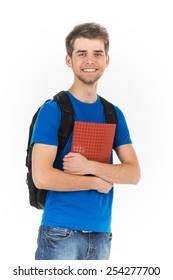 Portrait of young, successful, happy male student. boy isolated on white background holding notebook