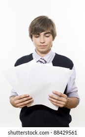 Portrait of young successful man with paper in hands