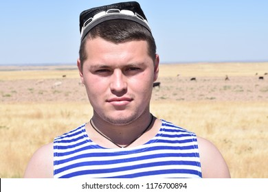 Portrait of a young Tajik with a skullcap