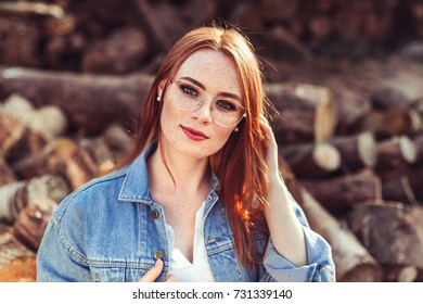 Portrait of young tender redhead young girl with healthy freckled skin wearing white top with serious or pensive expression. Caucasian woman model with ginger hair posing