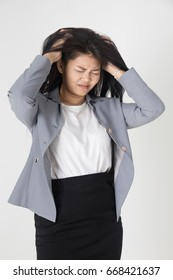 Portrait of Young Tired Business woman on gray background