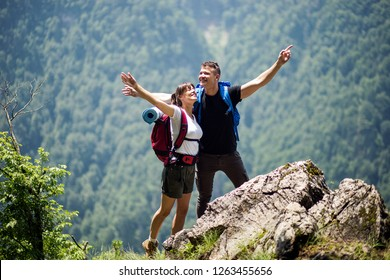 Portrait of young tourist couple in nature