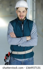 portrait of a young tradesman wearing a toolbelt