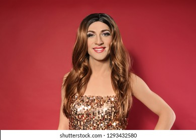 Portrait of young transgender woman on color background