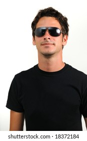 Portrait of young trendy man wearing sunglasses isolated
