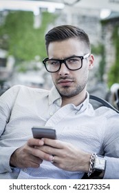 Portrait of young urban guy with mobile phone