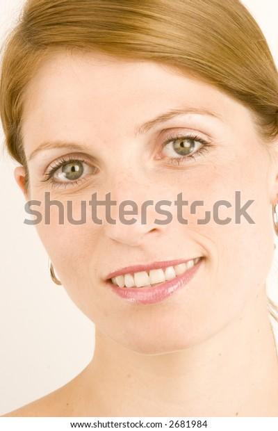 A portrait of a young woman against a plain background.