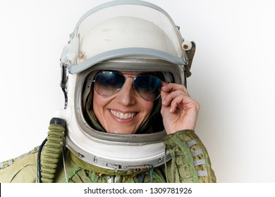 portrait of young woman airplane and warplane pilot with helmet and glasses of aviator photographed on isolated white background