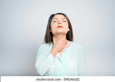 Portrait of a young woman angina ailing, sick throat