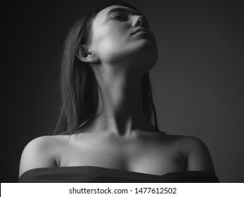 Portrait of young woman with bare shoulders. Black and white