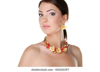 Portrait of young woman with beads, isolated on white background