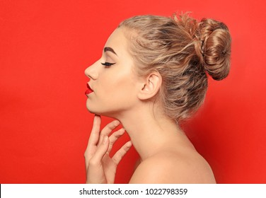 Portrait of young woman with beautiful eyebrows on color background