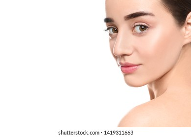 Portrait of young woman with beautiful face against white background
