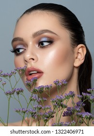 Portrait of young woman with beautiful makeup. Youth makeup, skincare, spring or summer concept. Studio shot