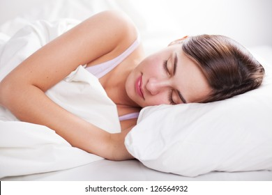 portrait of young  woman in bed
