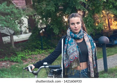 portrait of a young woman with bicycle