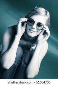 Portrait of young woman in big vintage sunglasses