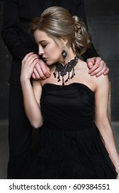 Portrait of a young woman in black dress. Wedding photos.