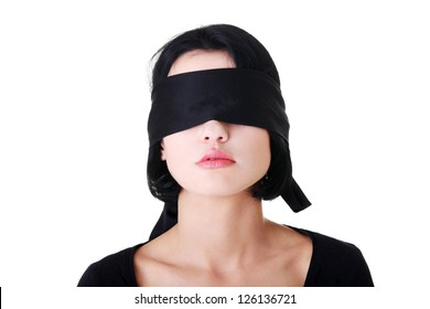 Portrait of the young woman blindfold , isolated on white