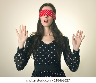 Portrait of the young woman blindfold. search