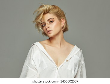Portrait of young woman with blond short hairstyle