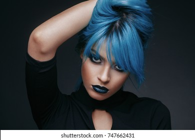 Portrait of a young woman with blue color hair