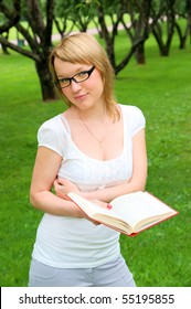 Portrait of young woman with book and glasses