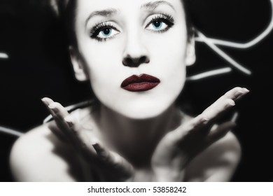 portrait of a young woman with bright makeup closeup
