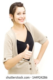 Portrait of a young  woman with cardigan and her thumb up over white background