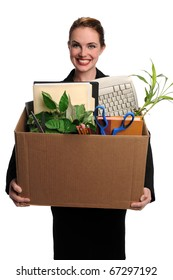 Portrait of young woman carrying office supplies in cardboard box isolated over white background