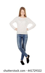 portrait of young  woman in casual wear with arms akimbo, looking to you. human emotion expression and lifestyle concept. image on a white studio background.