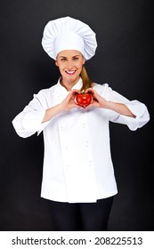 Portrait of young woman chef with tomatoes