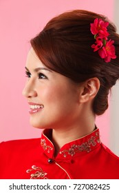Portrait of young woman in cheongsam
