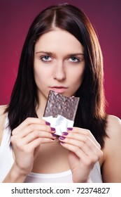 Portrait of young woman with chocolate